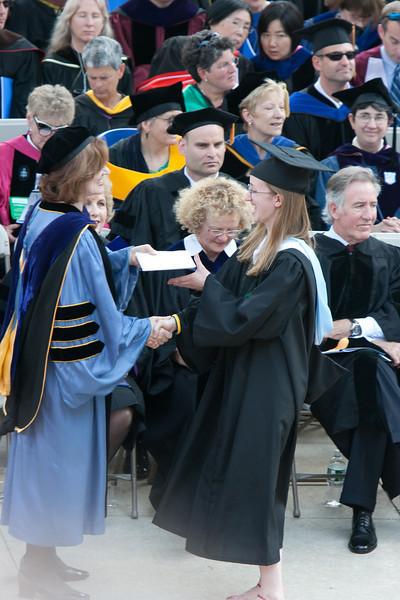Receiving her diploma.