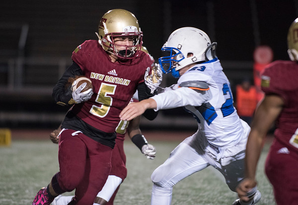 10/11/19 Wesley Bunnell | StaffrrNew Britain football vs Hall at Veterans Stadium in New Britain on Friday night. Travon Santoro (5) with a carry.