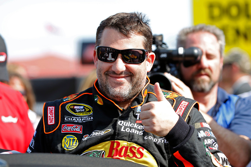 . Tony Stewart gives the thumbs up as he gets in his car for the Budweiser Duel 1 NASCAR Sprint Cup Series auto race at Daytona International Speedway, Thursday, Feb. 21, 2013, in Daytona Beach, Fla. (AP Photo/Terry Renna)