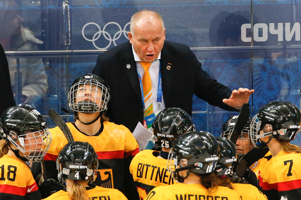 . German head coach Peter Kathan talks to the players during a break in the actions against Japan in the second period of the 2014 Winter Olympics women\'s ice hockey game at Shayba Arena, Tuesday, Feb. 18, 2014, in Sochi, Russia. (AP Photo/Petr David Josek)
