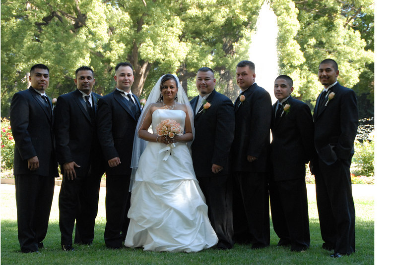 bride and groom w groomsmen.jpg