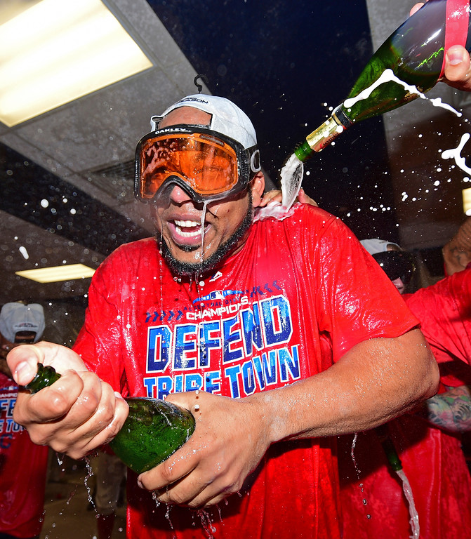 . Cleveland Indians\' Edwin Encarnacion celebrates in the clubhouse after the Indians defeated the Detroit Tigers 15-0 to clinch the American League Central Division, in a baseball game, Saturday, Sept.15, 2018, in Cleveland. (AP Photo/David Dermer)
