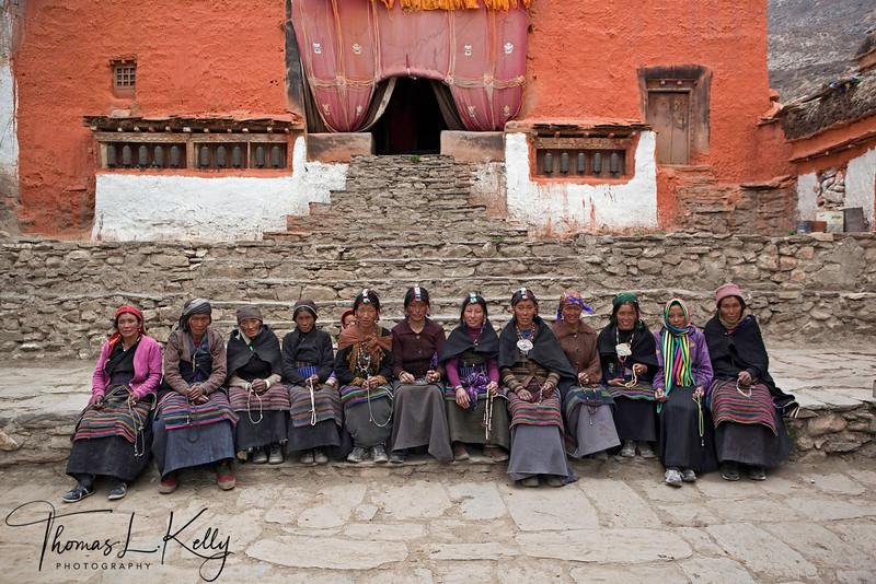 Mustangi women at Lo Ghyekar Goempa. Seen here is the main entrance to goempa. Mustang, Nepal.