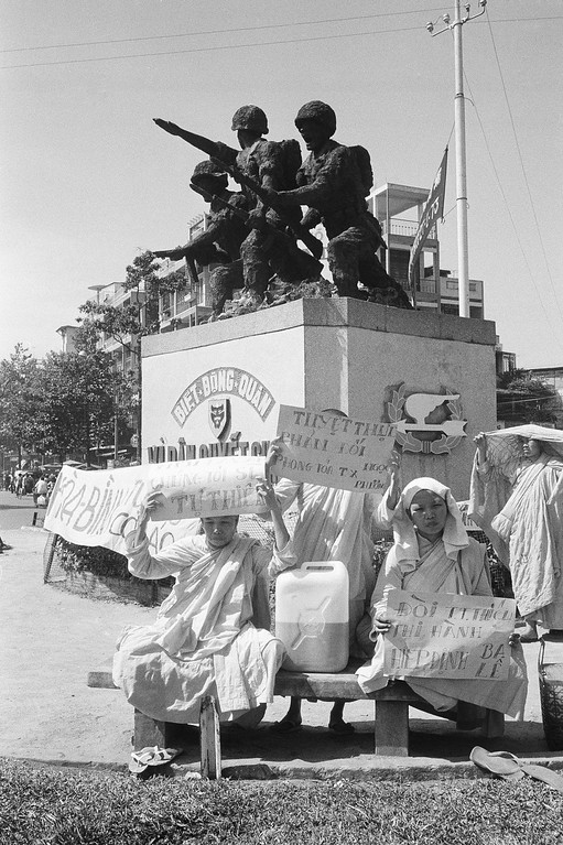 . South Vietnamese Buddhist nuns opposed to the regime of President Nguyen Van Thieu and continued fighting in their country stage a demonstration in the shadow of a monument honoring combatants in Saigon, Jan. 27, 1975. The nuns called on Thieu to resign. (AP Photo/Ut)