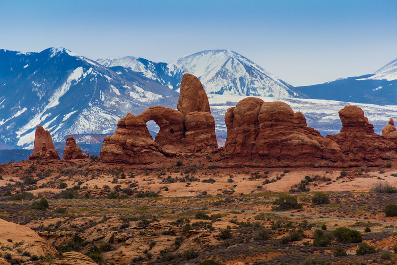 The La Sal Mountains backdrop Turret Arch in the Windows section of Arches N.P.