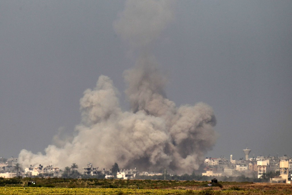 . In a picture taken from the Israel-Gaza border, smoke rises from the coastal side of the Gaza Strip following an Israeli controlled explosion of a tunnel, on August 1, 2014 after Israeli Prime Minister Benjamin Netanyahu announced the previous day that the army will continue working to destroy tunnels used by Gaza militants for cross-border attacks with or without a ceasefire. Even as troops have worked to destroy the tunnels, some of which have been booby trapped, militants have managed to use them to infiltrate southern Israel five times, Haaretz newspaper reported. AFP PHOTO / JACK  GUEZ/AFP/Getty Images