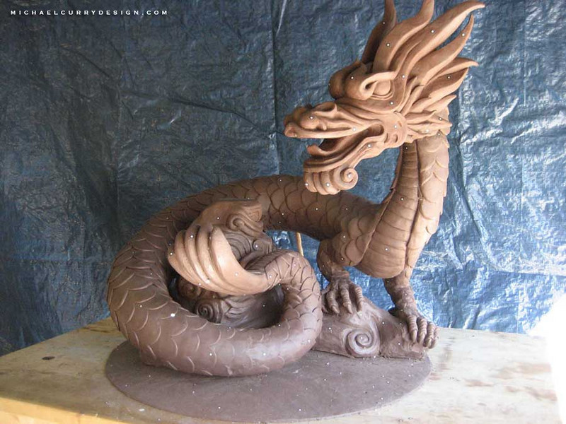 Scale model of Dragon in clay; small dots on sculpture are targets for digital scanning.