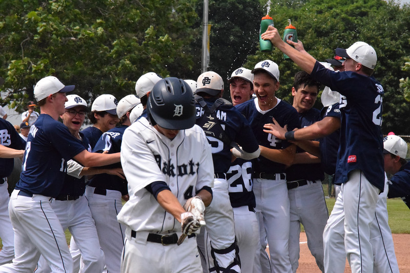 Grosse Pointe South celebrates its 9-1 win over MAC Red rival Dakota in a Division 1 state quarterfinal  game at Wayne State University.