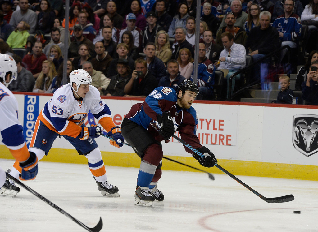 . DENVER, CO. - OCTOBER 30:  Colorado Avalanche center Ryan O\'Reilly #90 shoots against New York Islanders center Casey Cizikas #53 in the third period at the Pepsi Center Thursday evening, October 30, 2014. (Photo By Andy Cross / The Denver Post)