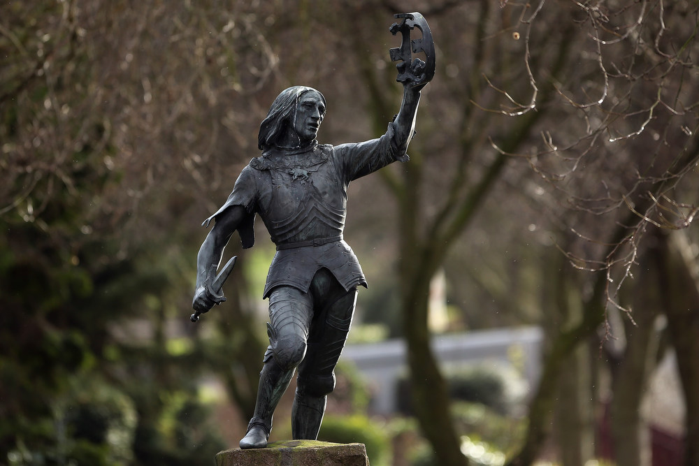 Description of . A statue of King Richard III stands in Castle Gardens near Leicester Cathedral, close to where the body of Richard III was discovered, on February 4, 2013 in Leicester, England. The University of Leicester has been carrying out scientific investigations on remains found in a car park to find out whether they are those of King Richard III since last September, when the skeleton was discovered in the foundations of Grey friars Church, Leicester. King\'s Richard III\'s remains are to be re-interred at Leicester Cathedral.  (Photo by Dan Kitwood/Getty Images)
