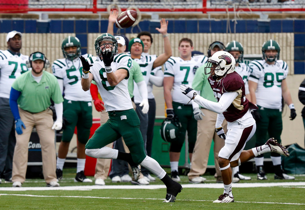 . Ohio wide receiver Chase Cochran (8) catches a 68-yard touchdown pass in front of Louisiana-Monroe safety Mitch Lane (38) during the first quarter of the Independence Bowl NCAA college football game in Shreveport, La., Friday, Dec. 28, 2012. (AP Photo/Rogelio V. Solis)