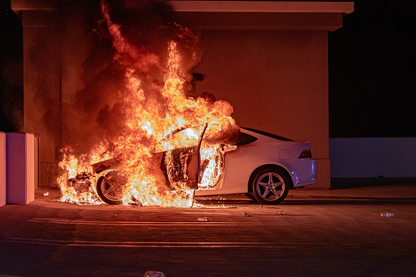 Tustin: Fire Destroys Car Atop Metrolink Parking Structure