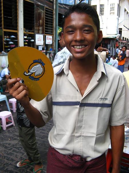 A tea boy at Aung San Market likes Smiling Albino too