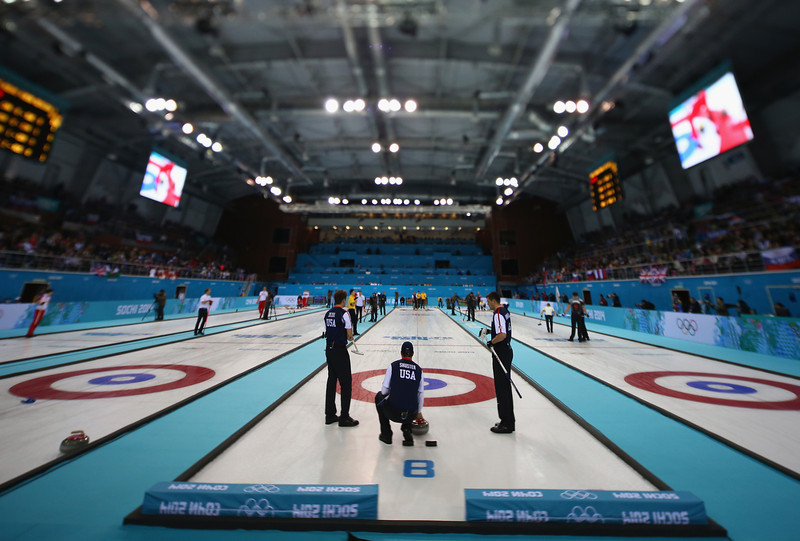 . (EDITORS NOTE: Image was created using a variable planed lens) Team USA competes in the men\'s round robin session against Germany during day four of the Sochi 2014 Winter Olympics at Ice Cube Curling Center on February 11, 2014 in Sochi, Russia.  (Photo by Streeter Lecka/Getty Images)