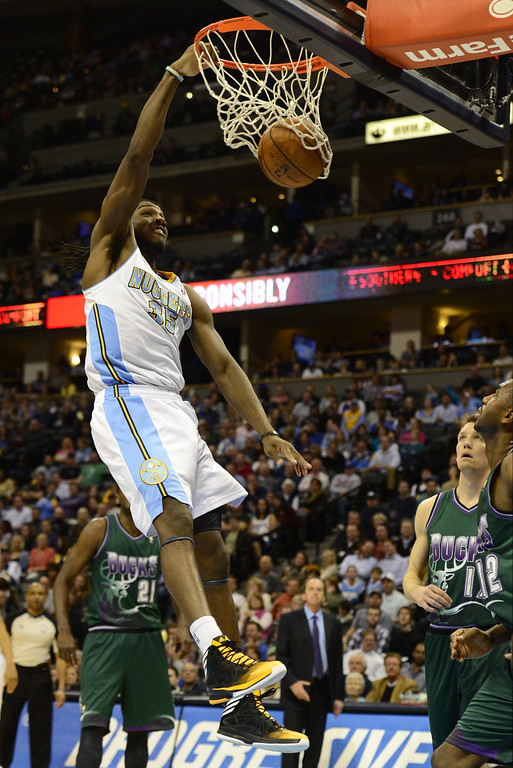 . DENVER, CO - FEBRUARY 5: Kenneth Faried Denver Nuggets (35) dunks against the Milwaukee Bucks during the second half of action. The Denver Nuggets defeat the Milwaukee Bucks 112-104 in NBA action at the Pepsi Center. (Photo By AAron Ontiveroz/The Denver Post)