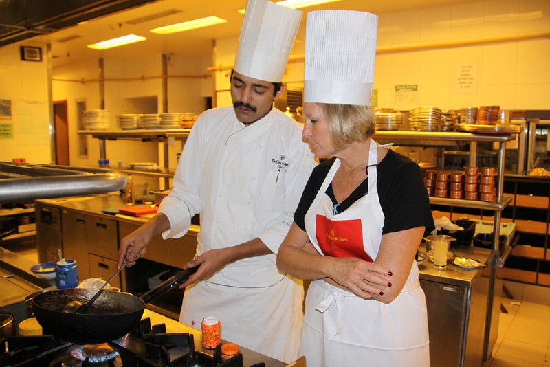 Bobbi cooking with chef at Oberoi