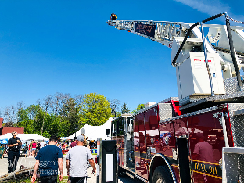 TLR-20190610-6865 Paramedic Jared Ornelas with Meggen's camera, up the fire truck ladder, Leland Wine Festival 2019