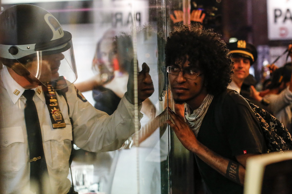 . A man gestures to a police officer during a Solidarity Baltimore rally on April 29, 2015 in New York City. Baltimore, Maryland remains on edge in the wake of the death of Freddie Gray, though the city has been largely peaceful following a day of rioting this past Monday. Gray, 25, was arrested for possessing a switch blade knife April 12 outside the Gilmor Houses housing project on Baltimore\'s west side. According to his attorney, Gray died a week later in the hospital from a severe spinal cord injury he received while in police custody.  (Photo by Kena Betancur/Getty Images)