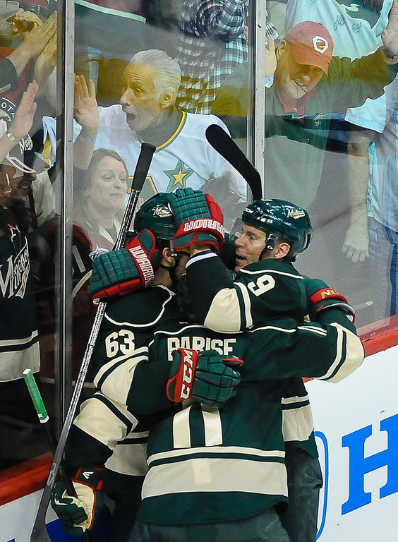 . Minnesota left wing Zach Parise, center, is hugged after scoring the Wild\'s tying goal by teammates Charlie Coyle, left, and Mikko Koivu in the third period against the Blackhawks.   (Pioneer Press: Ben Garvin)