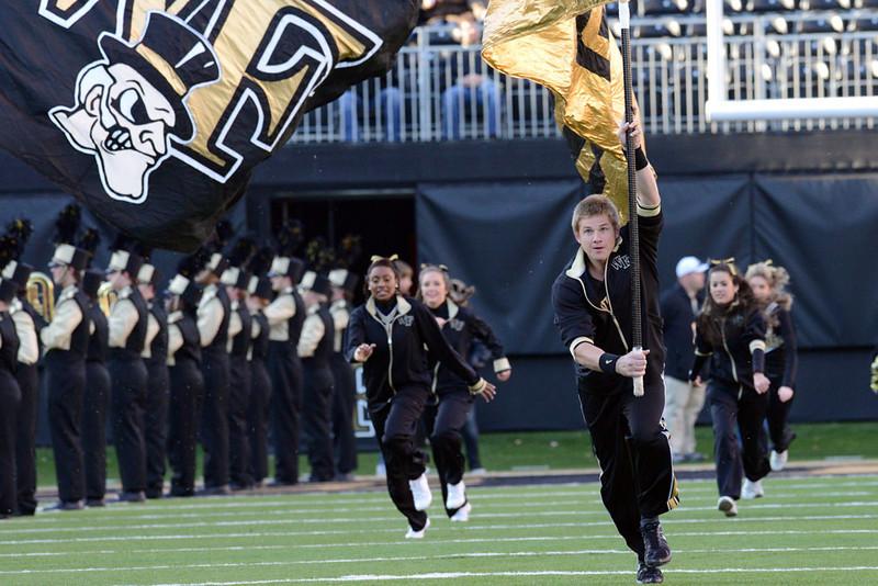 Cheerleaders run to to field.jpg
