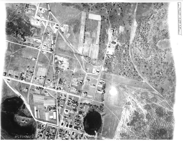 Aerial of Kenilworth in 1923. The street on the bottom is Washington Ave. The buildings in the upper right are the campus of Upsala College. The pond in the lower left is now the soccer field for the high school.