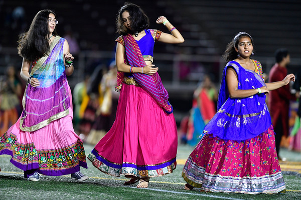 9/14/2019 Mike Orazzi | Staff Participants dance during the Indian festival Navaratri held at Veterans Memorial Stadium in New Britain on Saturday night.