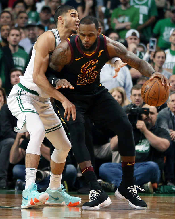 . Cleveland Cavaliers forward LeBron James dribbles against Boston Celtics forward Jayson Tatum, left, during the second half in Game 7 of the NBA basketball Eastern Conference finals, Sunday, May 27, 2018, in Boston. (AP Photo/Elise Amendola)