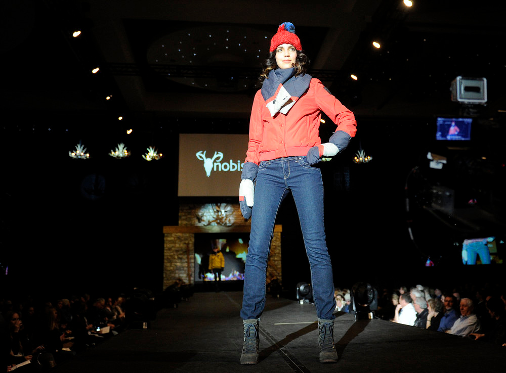 Description of . Nobis quilted red button jacket and chevron scarf  snow fashion as the SIA Snow Show hosted its 2013 Snow Fashion & Trends Show at the Colorado Convention Center  in downtown Denver  on Wednesday, January 30, 2013.  (Photo By Cyrus McCrimmon / The Denver Post)