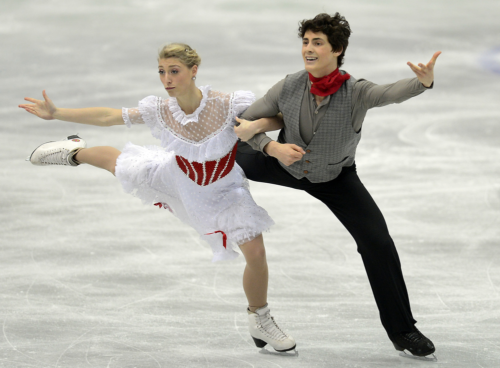 Description of . Piper Gilles and Paul Poirier of Canada skate in the Ice Dance Short Dance during day one of the ISU Four Continents Figure Skating Championships at Osaka Municipal Central Gymnasium on February 8, 2013 in Osaka, Japan.  (Photo by Atsushi Tomura/Getty Images)