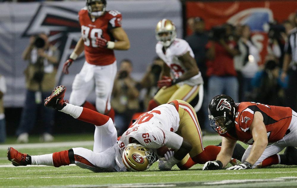 . San Francisco 49ers\' Aldon Smith recovers a fumble in front of Atlanta Falcons\' Matt Ryan during the second half of the NFL football NFC Championship game Sunday, Jan. 20, 2013, in Atlanta. (AP Photo/John Bazemore)