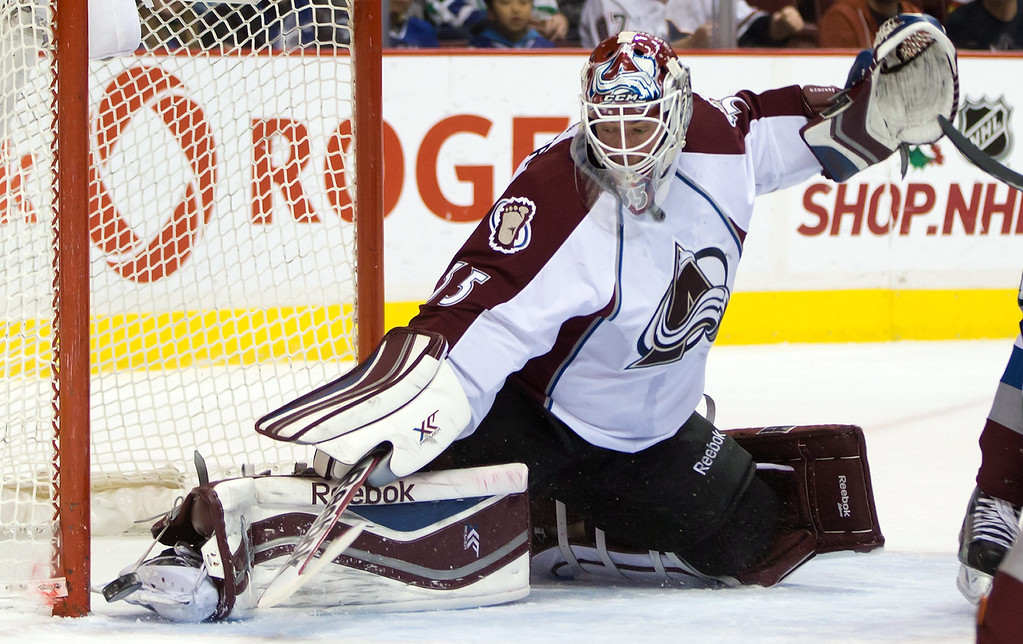 . Colorado Avalanche goalie Jean-Sebastien Giguere makes a save against the Vancouver Canucks during first period NHL hockey game in Vancouver, British Columbia on Sunday, Dec. 8, 2013. (AP Photo/The Canadian Press, Darryl Dyck)