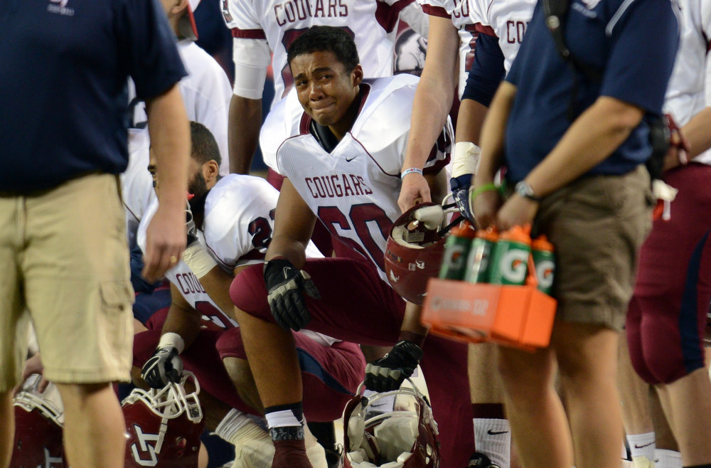 . Cherokee Trail DE Carl Matthews (6), shows emotion after losing the game against Valor Christian in the 5A State Championship game at Sports Authority Field at Mile High on Saturday in Denver, CO on December 1, 2012. Hyoung Chang, The Denver Post