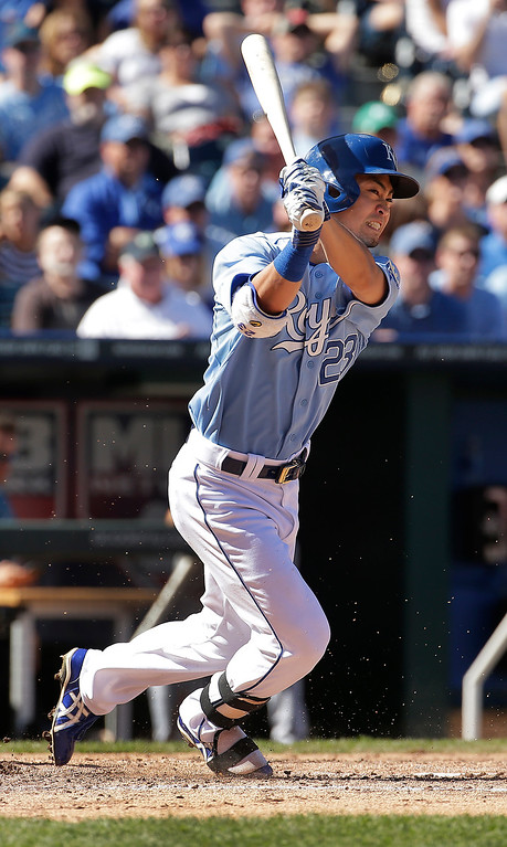 . Kansas City Royals\' Norichika Aoki hits a two-run triple during the fourth inning of a baseball game against the Detroit Tigers Sunday, Sept. 21, 2014, in Kansas City, Mo. (AP Photo/Charlie Riedel)