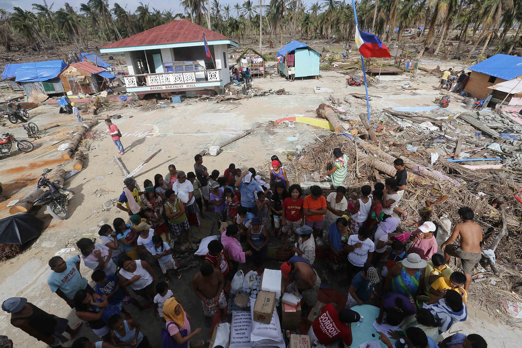 . Typhoon-affected Filipinos are gathered to receive relief goods in the coastal village of Batang in Hernani town of Eastern Samar Province, Philippines 21 November 2013.  EPA/ROLEX DELA PENA
