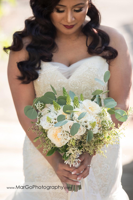bride looking down at wedding bouquet at Sunol's Casa Bella