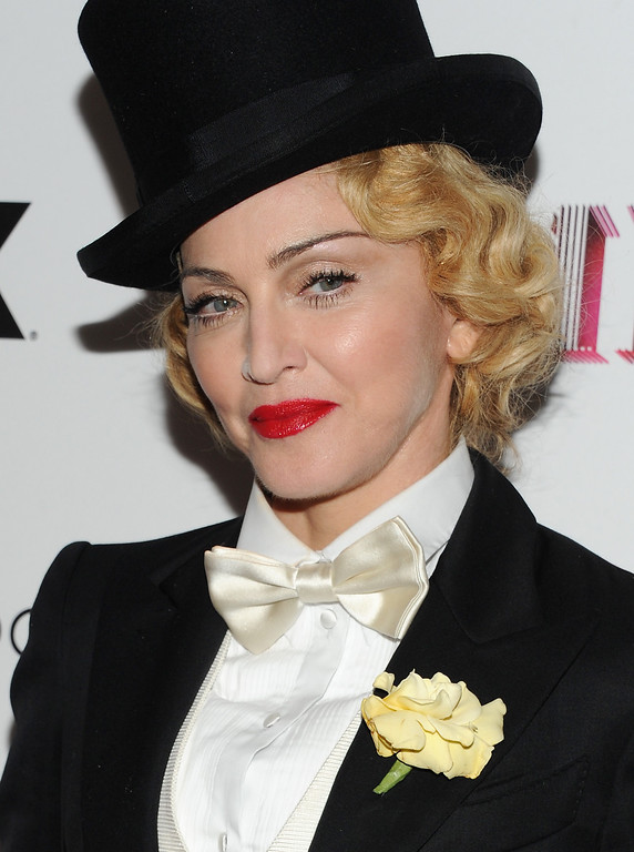 """. Singer Madonna attends the world premiere of \""""Madonna: The MDNA Tour\"""" hosted by The Cinema Society and Dolce & Gabbana at the Paris Theatre on Tuesday, June 18, 2013 in New York. (Photo by Evan Agostini/Invision/AP)"""