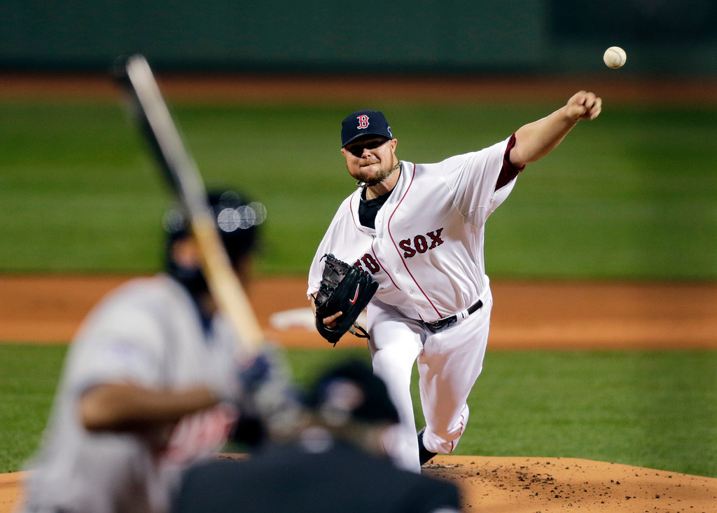 . Boston Red Sox starting pitcher Jon Lester throws against the Detroit Tigers in the first inning during Game 1 of the American League baseball championship series Saturday, Oct. 12, 2013, in Boston. (AP Photo/Charles Krupa)