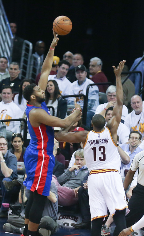 . Detroit Pistons\' Andre Drummond scores against the Cleveland Cavaliers\' Tristan Thompson during the first half of Game 1 of a first-round NBA basketball playoff series, Sunday, April 17, 2016, in Cleveland. (Kirthmon F. Dozier/Detroit Free Press via AP)