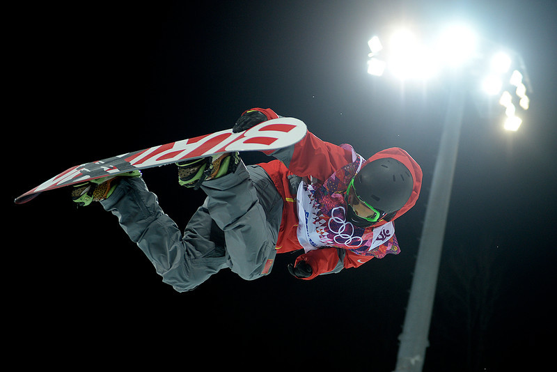 . China\'s  Shi Wancheng makes a grab during the men\'s snowboard halfpipe final. Sochi 2014 Winter Olympics on Tuesday, February 11, 2014. (Photo by AAron Ontiveroz/The Denver Post)