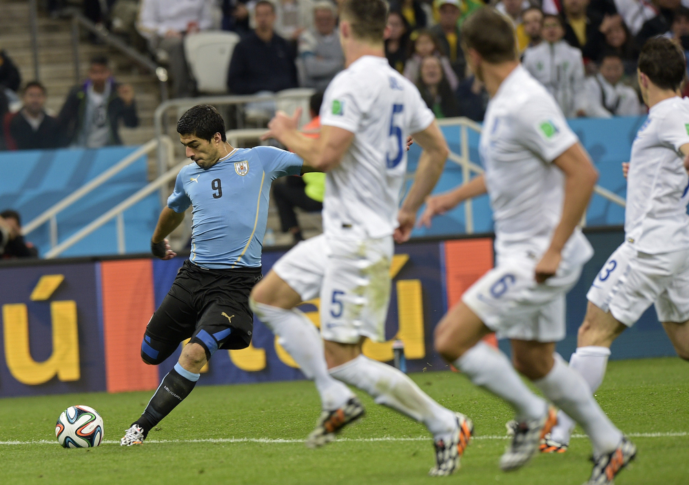 . Uruguay\'s forward Luis Suarez (L) kicks the ball during a Group D football match between Uruguay and England at the Corinthians Arena in Sao Paulo during the 2014 FIFA World Cup on June 19, 2014.  (DANIEL GARCIA/AFP/Getty Images)