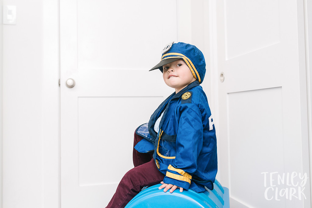 Little boy police costume dress-up. Lifestyle in-home family photoshoot in Marin, CA by Tenley Clark Photography.
