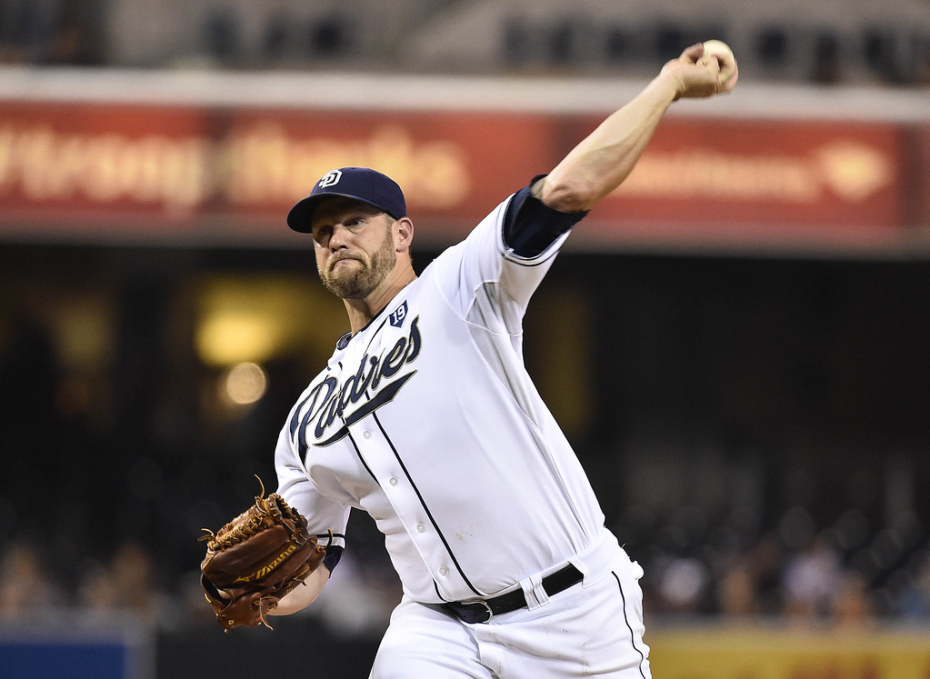 . SAN DIEGO, CA - SEPTEMBER 22:   Eric Stults #53 of the San Diego Padres pitches during the first inning of a baseball game against the Colorado Rockies at Petco Park September, 22, 2014 in San Diego, California.  (Photo by Denis Poroy/Getty Images)
