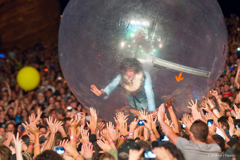 "Wayne Coyne Riding the crowd in his bubble The Flaming Lips Performing Pink Floyd's ""The Dark Side of the Moon"" Red Rocks Amphitheater Morrison, CO August 4, 2011"