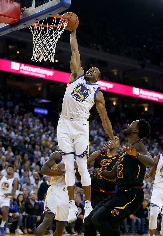 . Golden State Warriors forward Andre Iguodala (9) dunks against the Cleveland Cavaliers during the second half of an NBA basketball game in Oakland, Calif., Monday, Dec. 25, 2017. The Warriors won 99-92. (AP Photo/Tony Avelar)