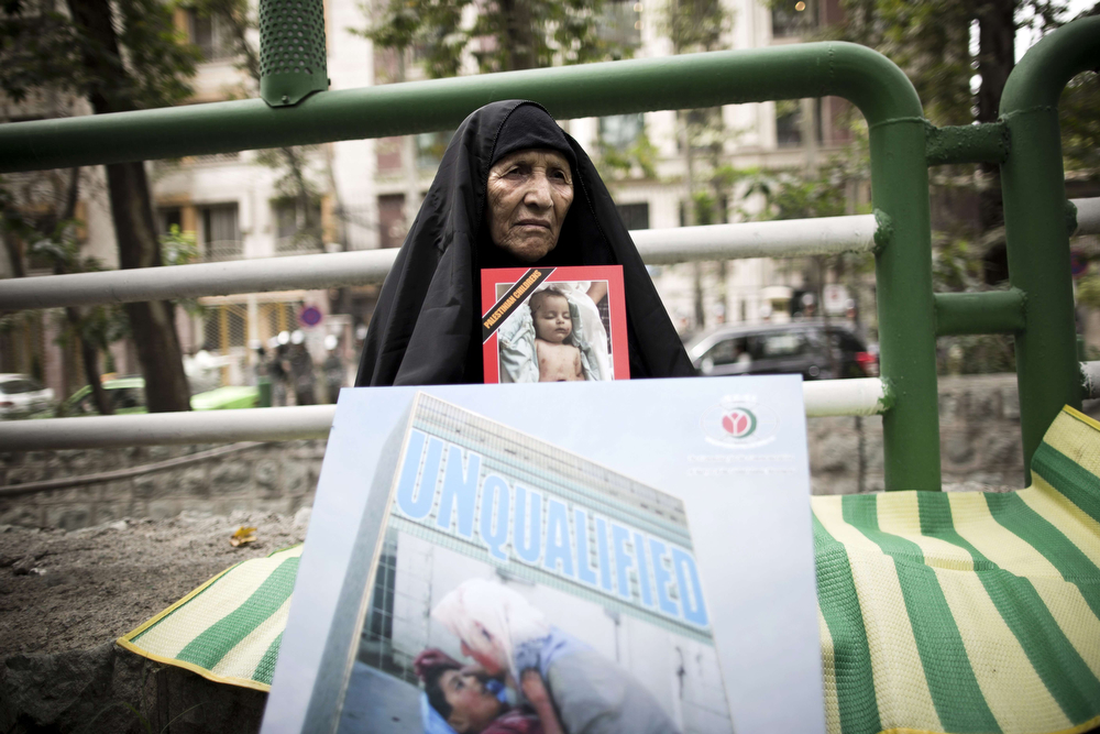 . An Iranian woman holds portraits of Palestinian children killed in Israeli air strikes during a small protest outside the United Nations offices in Tehran on July 15, 2014 against Israel\'s deadly air offensive on the Gaza Strip this month. AFP PHOTO/BEHROUZ MEHRIBEHROUZ MEHRI/AFP/Getty Images