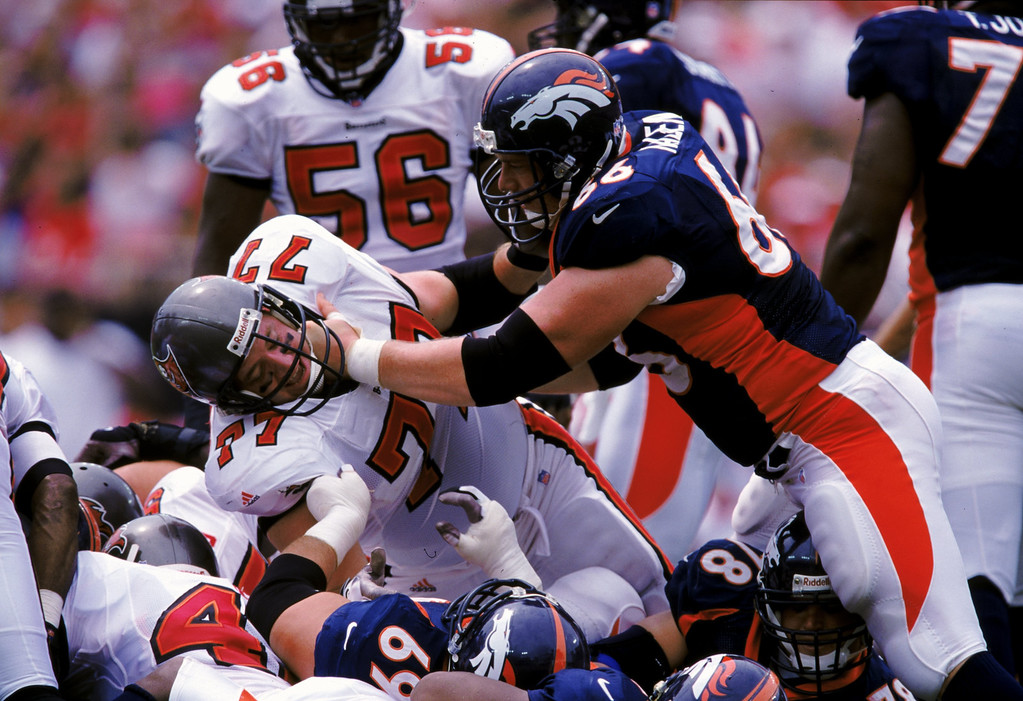 . 26 Sep 1999: Tom Nalen #66 of the Denver Broncos tackles Brad Culpepper #77 of the Tampa Bay Buccaneers at the Raymond James Stadium in Tampa Bay, Florida. The Buccaneers defeated the Broncos 13-10. Credit: Andy Lyons  /Allsport