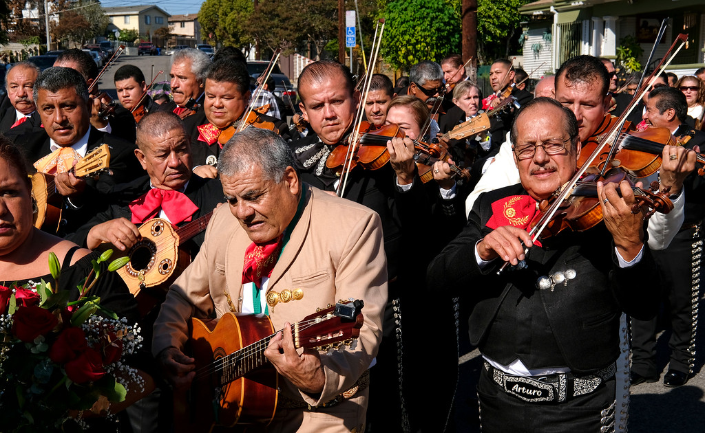 . Mariachis play in the street during the Santa Cecilia festival and procession in the Boyle Heights section of Los Angeles on Tuesday, Nov. 22, 2016. Musicians from around the country gathered for Mariachi Sol de Mexico to celebrate Santa Cecilia. The festival honors Santa Cecilia, the patron saint of musicians. (AP Photo/Richard Vogel)