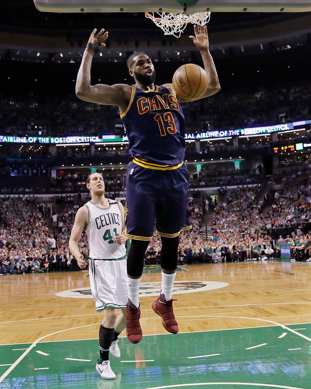. Cleveland Cavaliers center Tristan Thompson (13) follows through on a dunk in front of Boston Celtics center Kelly Olynyk (41) during the second quarter of Game 1 of the NBA basketball Eastern Conference finals, Wednesday, May 17, 2017, in Boston. (AP Photo/Charles Krupa)