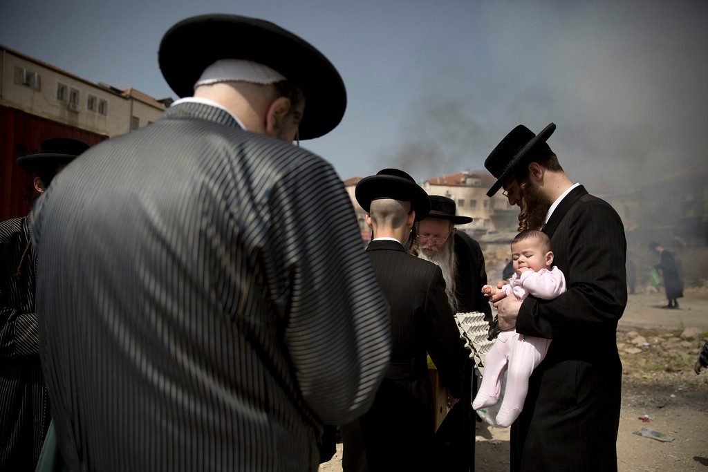 . Ultra-Orthodox Jewish men burn leavened items in final preparation for the Passover holiday in Jerusalem, Friday, April 22, 2016. Jews are forbidden to eat leavened foodstuffs during the Passover holiday that celebrates the biblical story of the Israelites\' escape from slavery and exodus from Egypt. (AP Photo/Oded Balilty)