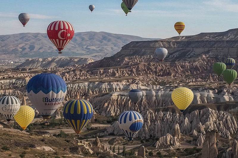 Floating in a virtual sea of balloons, we cruise over the moon-like rock formations of the Göreme Valley